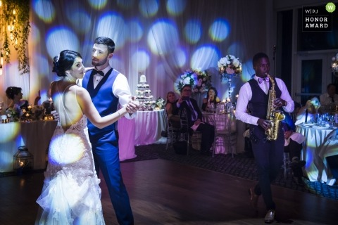 Pictures of a couple dancing under lights by a top Toronto wedding photographer