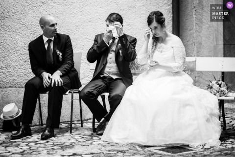 Bevaix, Switzerland wedding photography of bride and groom wiping tears during ceremony