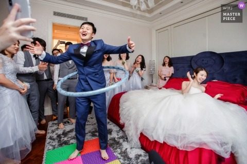 Hangzhou City wedding photos of groomsmen hulahoop in Zhejiang