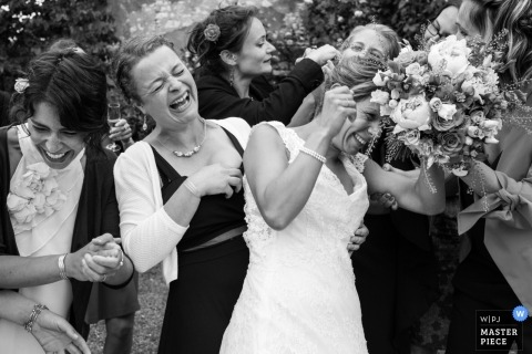 Wedding reception photography of bride laughing with bridesmaids in France | coverage for Nouvelle-Aquitaine weddings