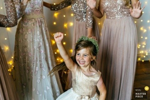Cheerful Chilli Barn, Otley | Very happy flower girl pumps fist in the air | Northamptonshire Wedding Photographer