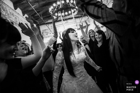 dancing and smiling bride at her wedding reception party