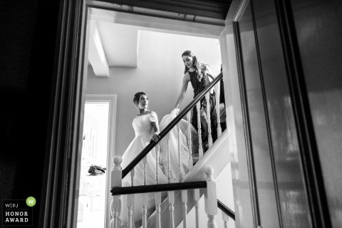 Wedding photo shoot of bride coming down the stairs in Harpenden, UK