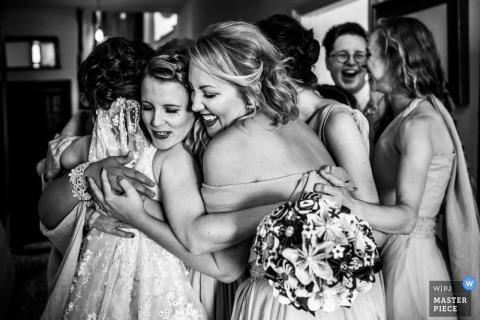 A big Bridal party hug | Devon wedding photography