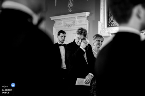 wedding photography in Dublin, Ireland of dad wiping tears during the ceremony