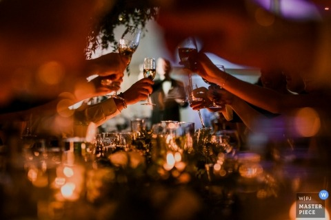 Denver Wedding, Colorado Wedding Photographer | Cheers! Toasing in low light at the wedding reception.