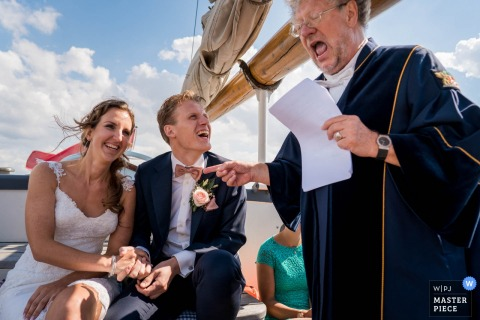 elopement wedding photography on a boat in Netherlands | laughter during the ceremony