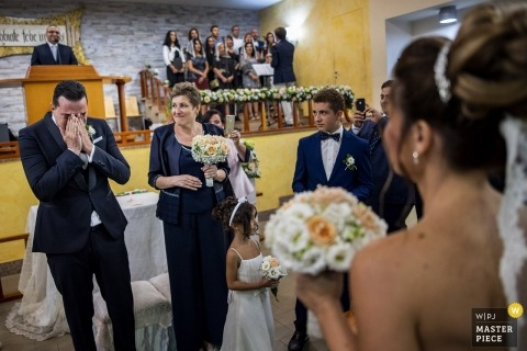 Reggio, Calabria groom getting emotional when seeing bride during the wedding ceremony