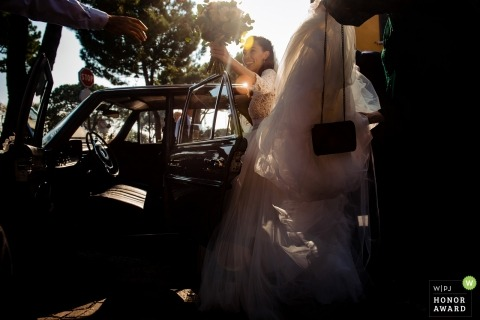 Wedding shoot with Italy bride getting out of car with bouquet - sirmione lake garda italy