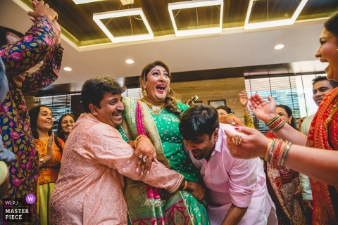 Wedding reception picture of guests having fun by Mumbai, India wedding photographer