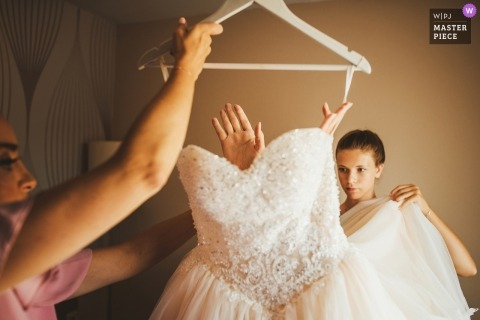Slovenia wedding photography of bride's dress on a hanger during getting ready