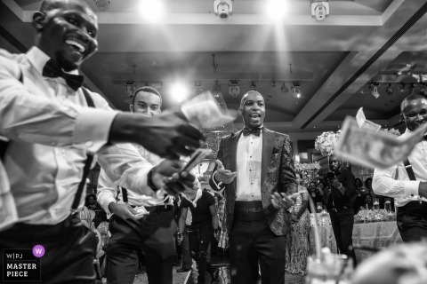 London wedding reception photograph of money flying in the air