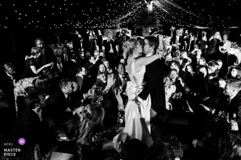 Wedding reception photo of bride and groom dancing | coverage for Suffolk, UK weddings