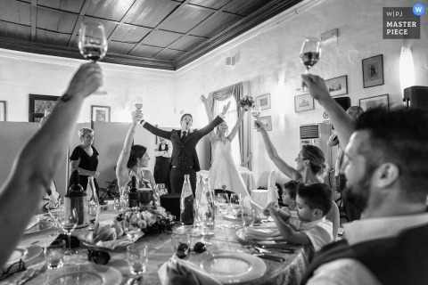 Wedding reception picture of a table toast by Venice wedding photographer