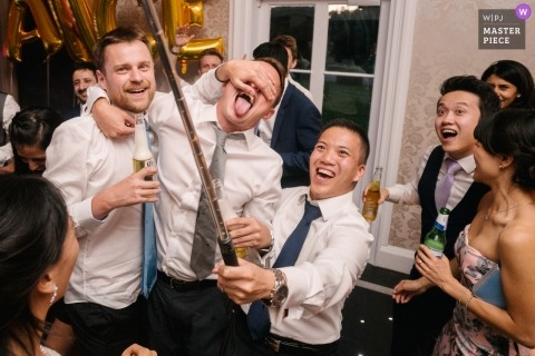Botleys mansion, surrey, England | London Wedding Photography of guys taking selfie at reception party