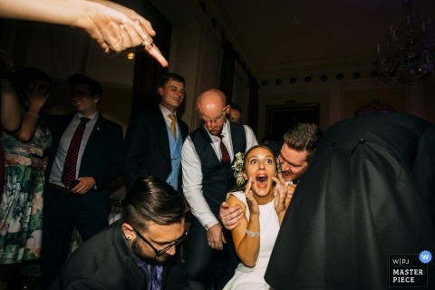 Wedding reception picture of happy bride by London wedding photographer