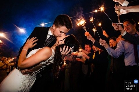 Valencia, Spain wedding reception photography of groom dipping bride near guests with sparklers