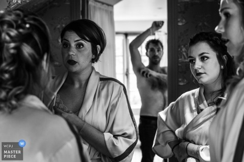 Abbaye de Morienval wedding photography of bride and bridesmaids getting ready in robes