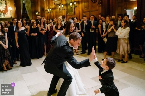 Manhattan, New York  wedding reception photography of groom giving high-five to ring bearer