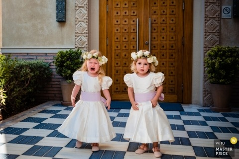 Dubai Wedding Photographer - United Arab Emirates One & Only Resort, The Palm Dubai Wedding Photography of flower girls, one is crying