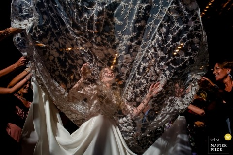 Rio de Janeiro wedding photographer | bride with dress fanned out during reception on dance floor