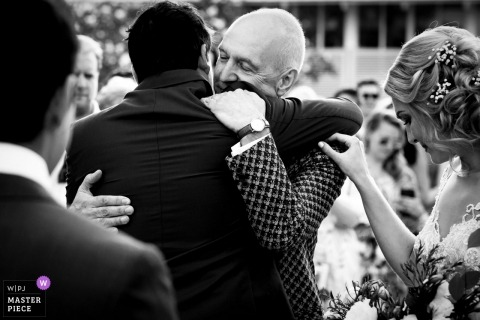 wedding photography of dad getting a hug in Thailand | family love during the ceremony