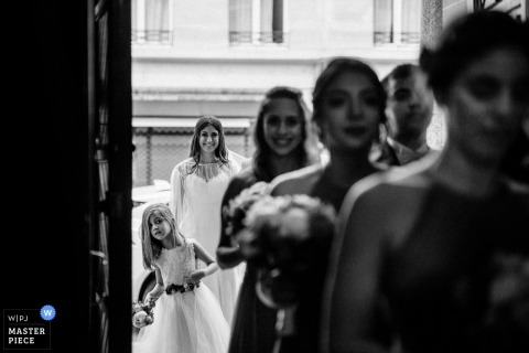 ile-de-France bride and flower girl wait to enter the church before the wedding ceremony