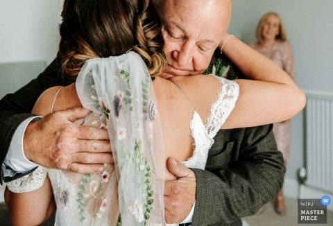 Wedding photography of dad hugging bride |  England and Shropshire wedding photography