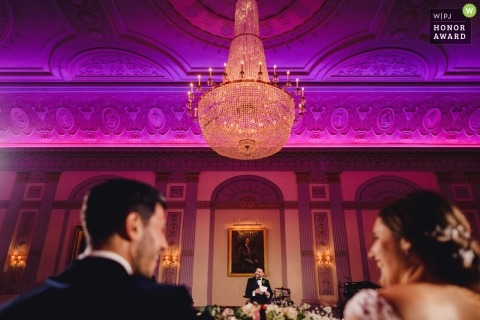 London  wedding shoot with a couple at the head table during their reception speeches