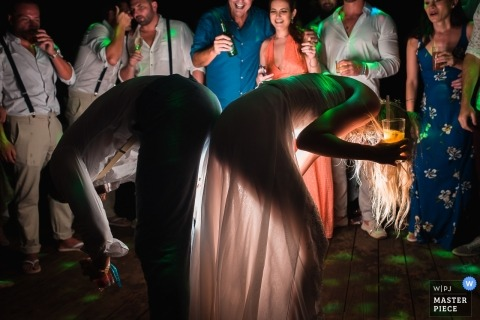 Brazil wedding reception photography with cool lighting on dancing guests
