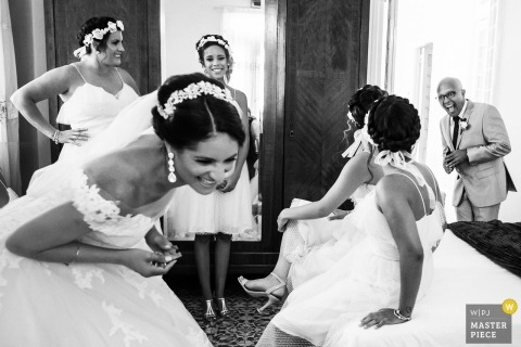 Cuba wedding photography of bride and bridesmaids getting ready for a ceremony in Havana