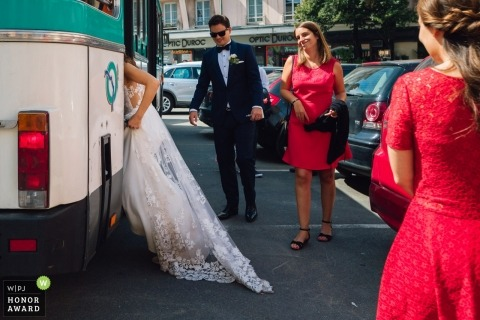 Wedding shoot with Paris couple loading into bridal party bus