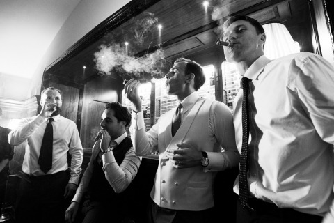 groom and bestfriends with cigars