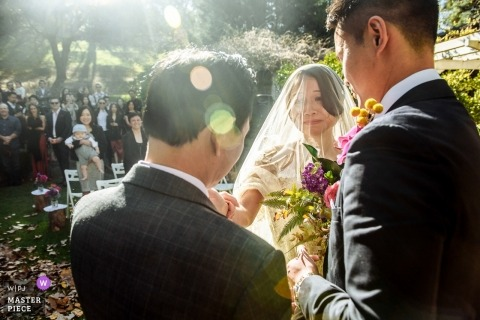 Perth Vineyard outdoor wedding ceremony in the sun for this bride and groom