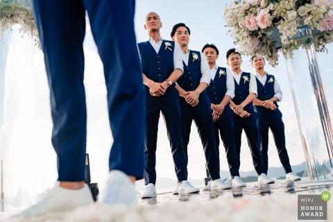Sripanwa, Phuket. Groomsmen lined up during outdoor beach wedding ceremony