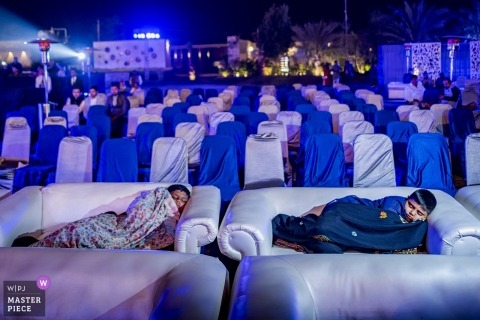 india wedding day - children who sleep on sofa couches during the reception party