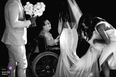 Mont Du Soleil, Kalista, Australia wedding photograph of the bride holding and the hand of a woman seated in her wheelchair
