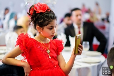 Wedding picture of young girl in a red dress at the CSN Building Birmingham