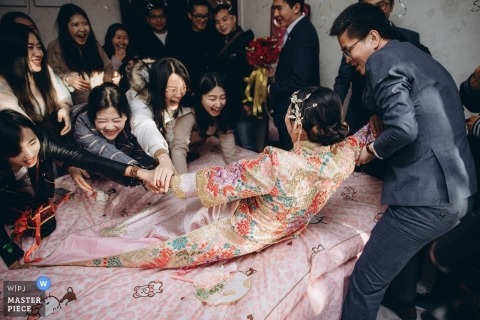 Bride's home in china with relatives trying to fight the groom for his bride