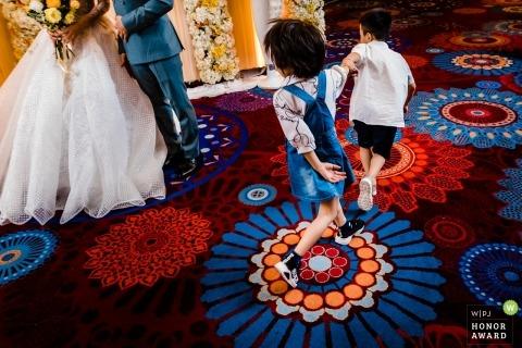 Windsor Plaza - HCMC wedding photo of kids playing | Follow me!