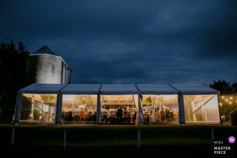 Berry, Australia reception photo - The wedding venue was tented with clear panels near silos