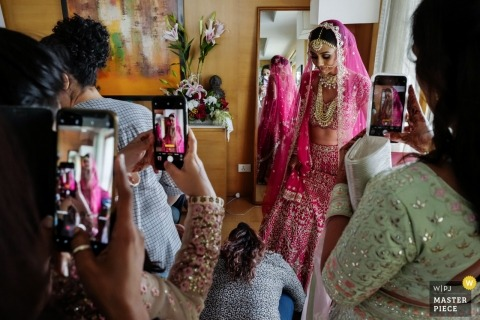 Mumbai, India wedding photography - many Mobile devices during Bride getting ready