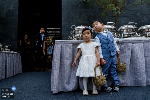 beijing wedding ceremony outdoors - Photo of the groom waiting for the ceremony with two Young flower children