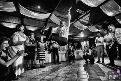 Marousi wedding reception dance floor action - a guest Flying high
