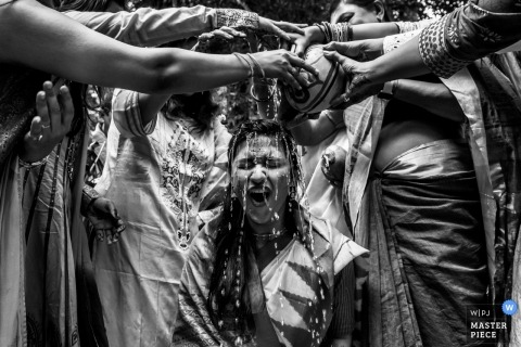 goa bride during the haldi ceremony. Wedding photograph in black-and-white
