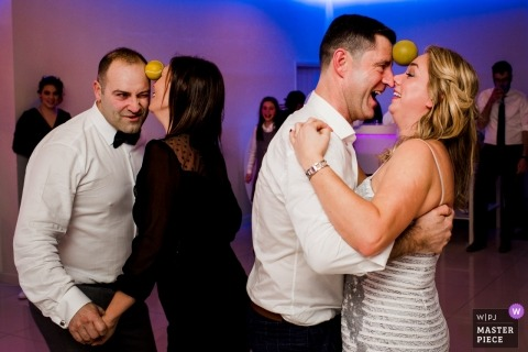 Santo Tirso, Portugal - Game during Wedding Party. The couples needed to dance without the ball fall of.