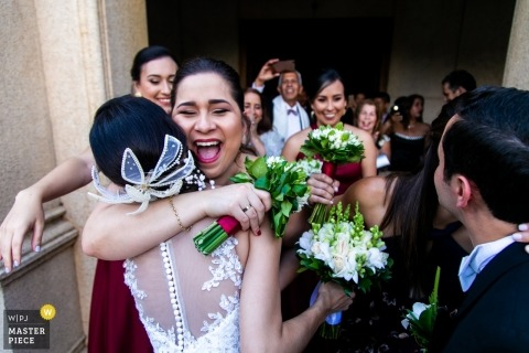 Caracas wedding photographer - You finally did it!!.. Hugs following the wedding ceremony