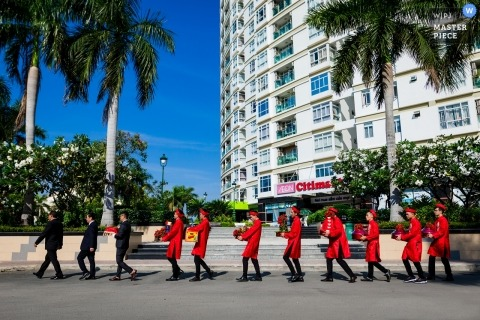 HCMC - Viet Nam | Let's go pick up the bride … the groomsmen make their way down the street dressed in red