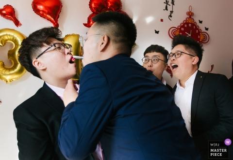 TianJin Mischief lipstick for these groomsmen during the door games in China