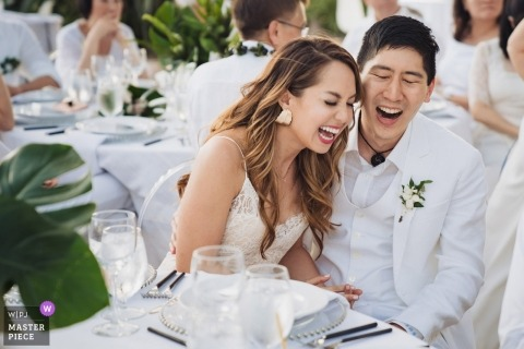 Bride and groom reception laughing in Maui, Hawaii - Olowalu Plantation House